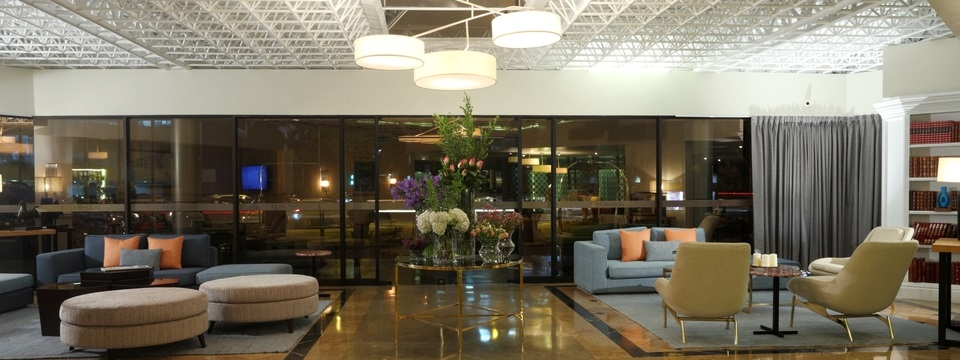 Hotel lobby with wall of windows and sofas