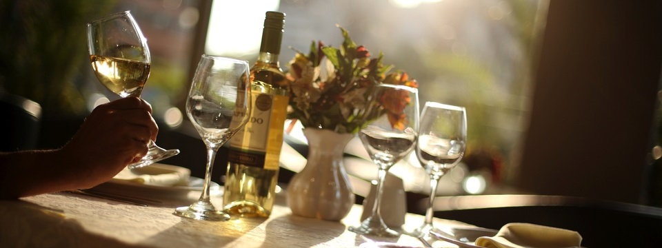 Bottle and glasses of wine at restaurant