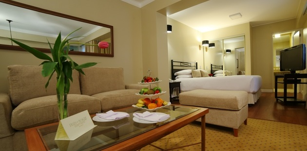 Hotel room with seating area that includes fruit tray