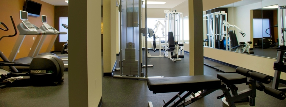 Hotel fitness center with exercise machines and mirrors