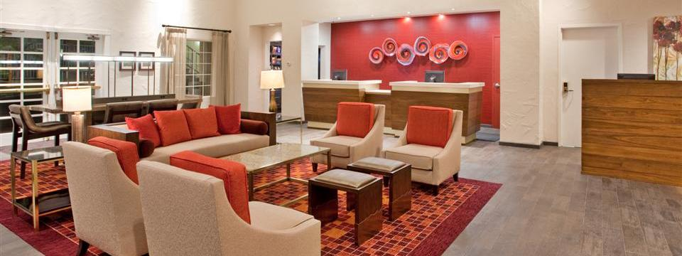 Hotel lobby with reception desk and seating