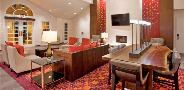 Hotel lobby with a flat-screen TV above the fireplace