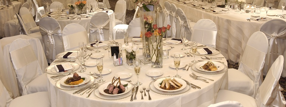 Wedding reception with round tables with white linens