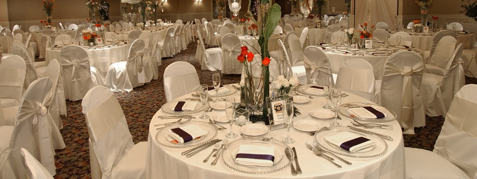 Reception space set up with round tables with white linens