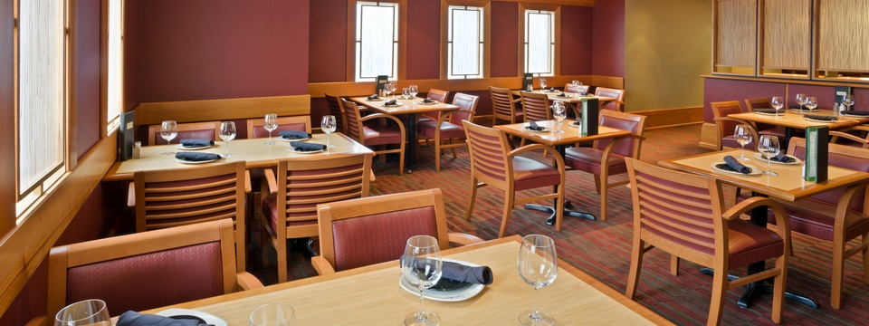Hotel's restaurant featuring warm wood tones