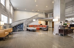 Welcoming lobby with a grand staircase and comfortable seating