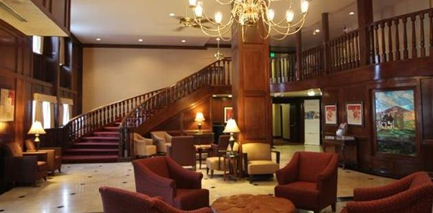 Spacious lobby with grand staircase and comfortable seating