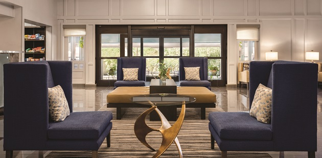 Spacious lobby with dark blue chairs and modern decor