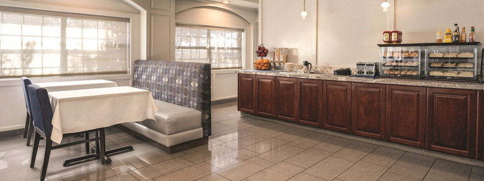 On-site dining area with fruit, cereal, assorted pastries and comfortable seating