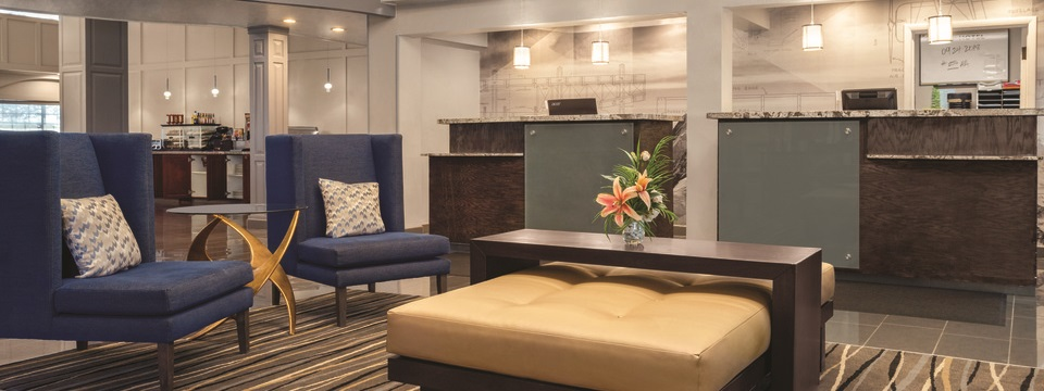 Seating area with dark blue chairs in front of the reception desk