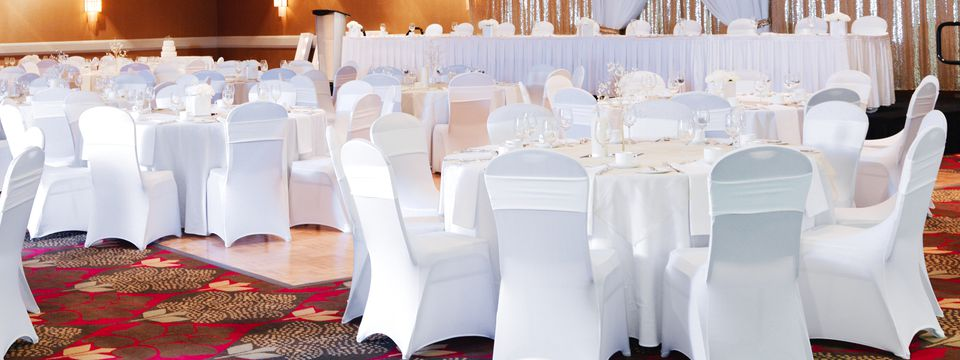Reception with white chairs and tables