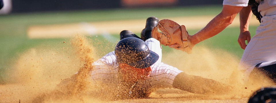 Baseball player sliding onto plate
