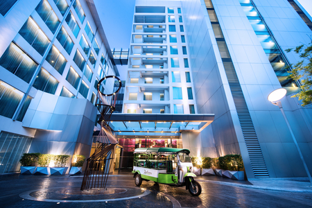 Exterior of Radisson Suites Bangkok Sukhumvit with tuk-tuk service