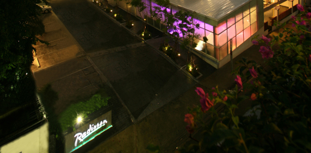 Exterior of Radisson Suites Bangkok Sukhumvit at night