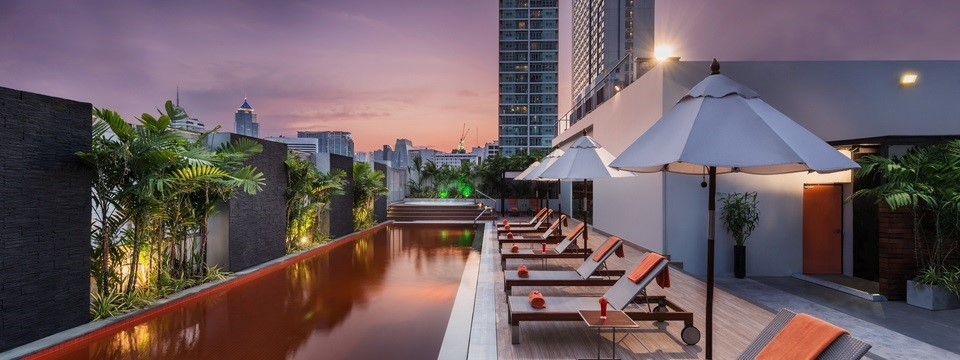 Rooftop Bar with an outdoor pool and a hot tub
