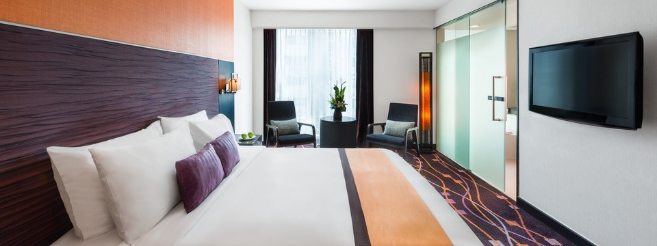 Superior King Room with purple and orange accents