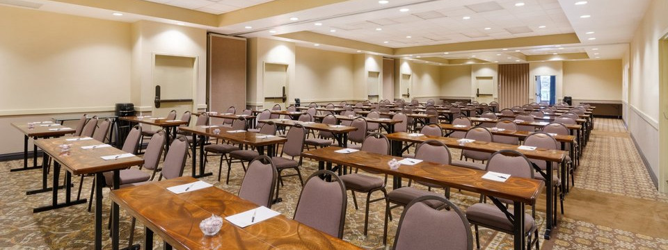 Nashville meeting room with rows of tables and chairs facing the front of the room