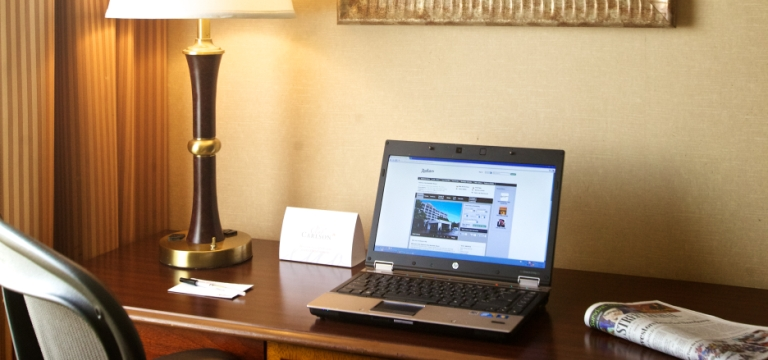 Work desk with laptop and lamp at our Nashville hotel