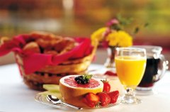 Breakfast spread featuring grapefruit, strawberries, coffee and orange juice