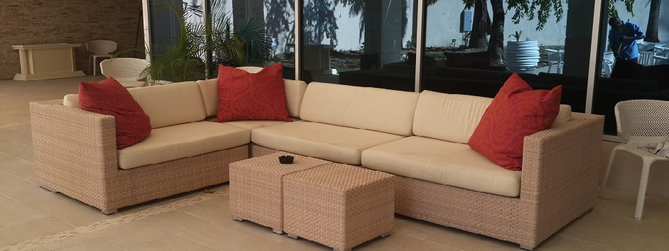 Outdoor patio seating with red accent pillows