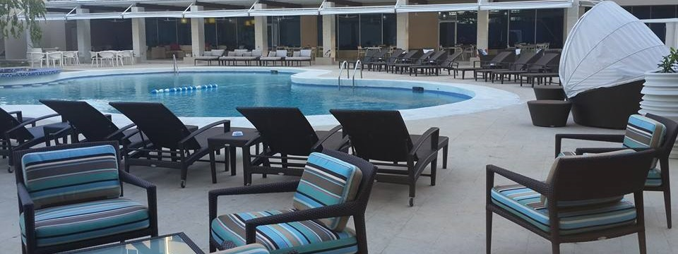 Poolside seating includes canopied chairs