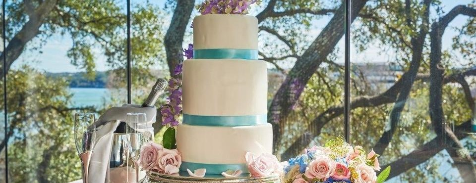 Wedding cake and champagne against scenic outdoor background