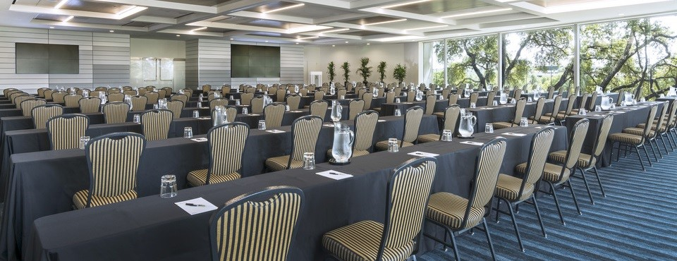 Tables and chairs lined up for a presentation