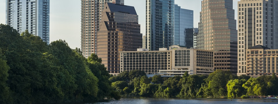 Exterior of the hotel overlooking greenery in Austin