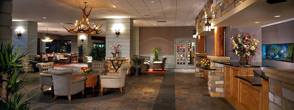 Spacious lobby with seating and gift shop