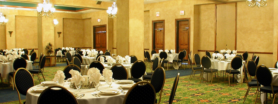 Elegant banquet space with round tables at our waterfront hotel