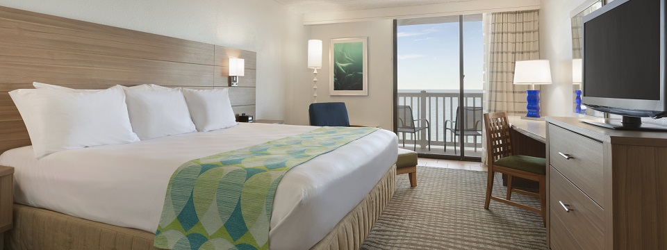 Corpus Christi hotel room overlooking the ocean with king bed and balcony
