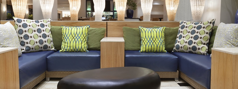 Comfortable lobby seating featuring blue leather sofas