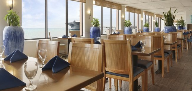Seaside dining room with blue vases