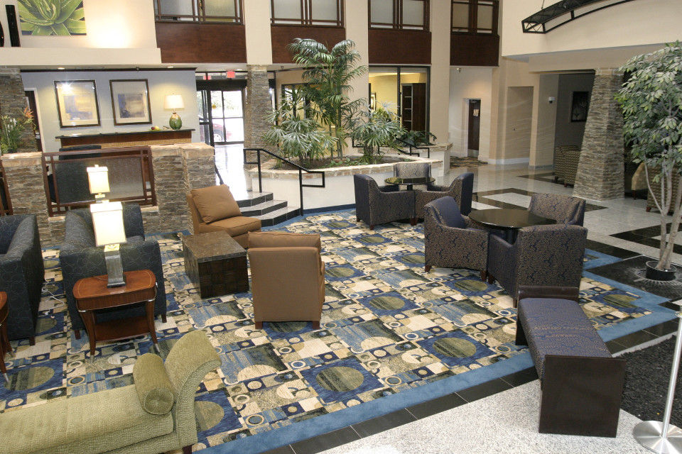 Lobby at Radisson Fort Worth North includes several seating areas