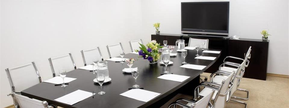 Bright boardroom with large-screen TV