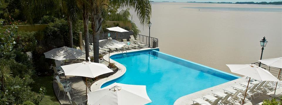 Colonia hotel's infinity pool overlooking the river