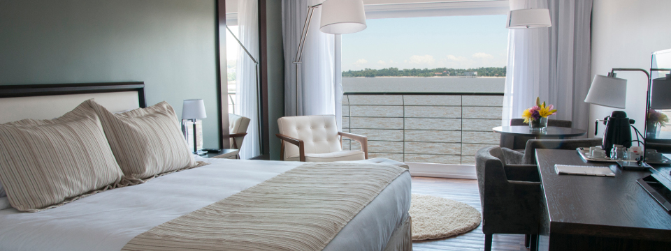 Deluxe Room with king bed and riverfront balcony