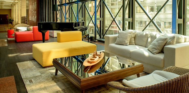 Stylish seating area with white, yellow and red couches