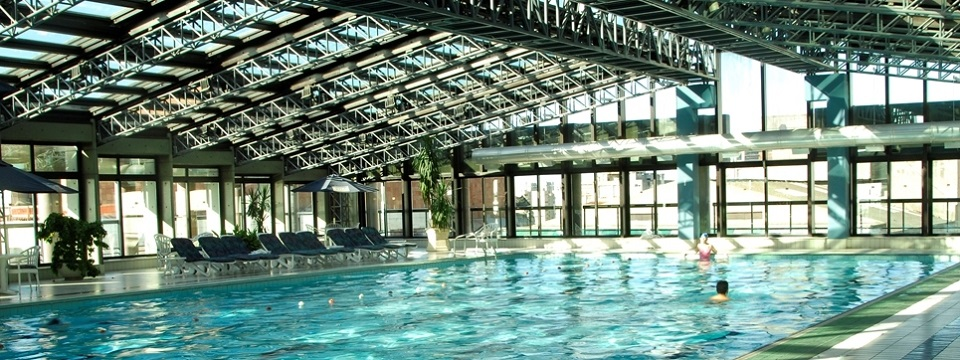 Sparkling indoor pool with swimming lanes and lounge chairs