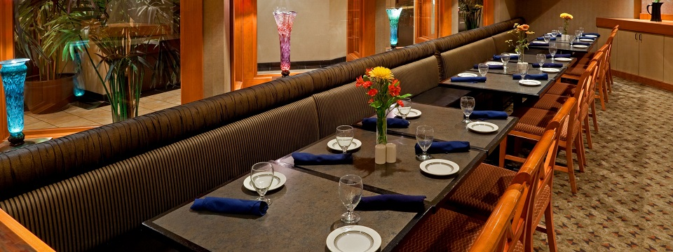 Inviting hotel restaurant with tables, chairs and booths
