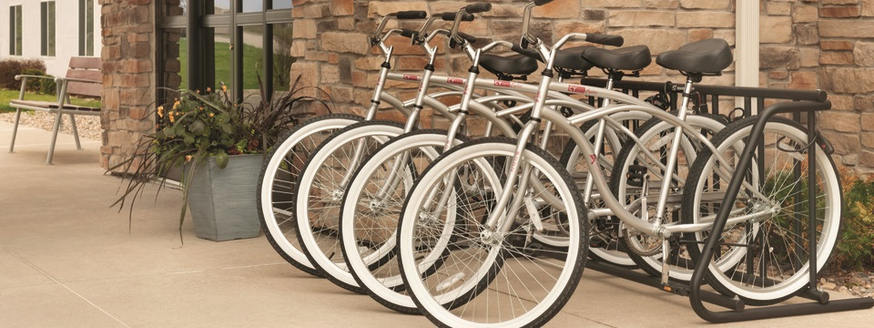 Bike rack with four bicycles outside the hotel