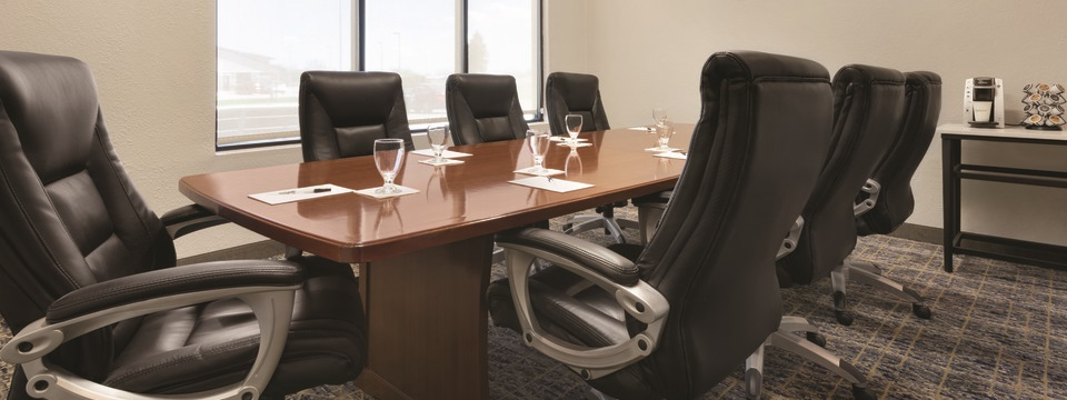 Boardroom featuring black leather chairs, meeting stationery and coffee facilities