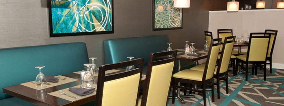 Elements dining area with tables, chairs and teal booths