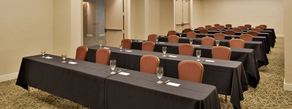 Side view of tables and chairs set up for a presentation in Marietta meeting room