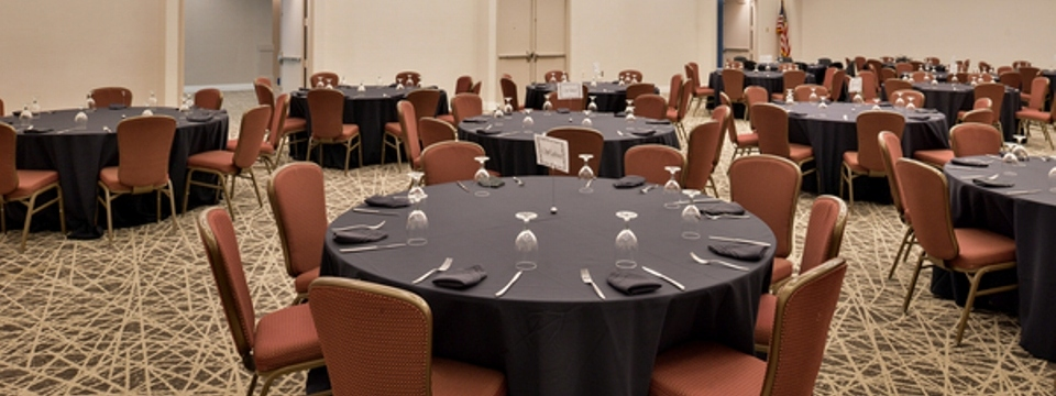 Round tables with cutlery and chairs in Marietta meeting space
