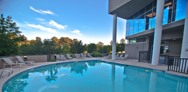 Sparkling hotel pool under blue sky in Marietta, GA