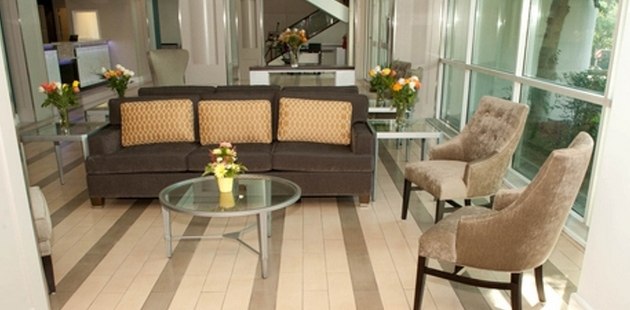 Spacious lobby with a couch, plush chairs and flower arrangements