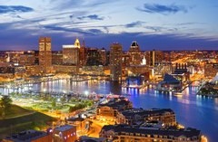 Aerial view of Baltimore skyline at dusk