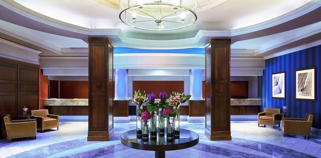 Elegant Lobby Featuring Reception Desk Chairs And Fl Arrangements