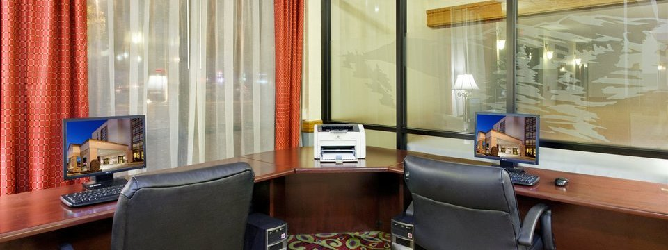 Two computers and a printer in our hotel's business center